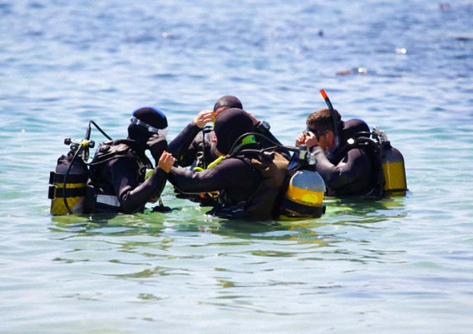 Divers preparing to dive